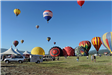 Row of Hot Air Balloons Being Filled