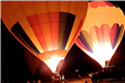 Two Hot Air Balloons at Night