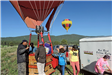 People Getting Into Hot Air Balloon