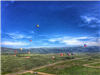Far Away View of Hot Air Balloons Flying