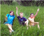 Kids Playing in Tall Grass
